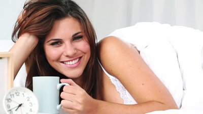 stock-footage-woman-drinks-coffee